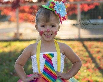 Rainbow Clown tutu dress costume with mini top hat. Pink, turquoise, lime green, purple.