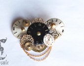 Gold, Black and Silver Steampunk Victorian Brooch with Vintage Watch Dials, Antique Watch Parts, Filigree Metal Decorations and Chains