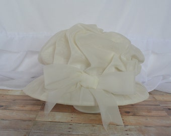 Vintage white hat with gathered fabric and bow