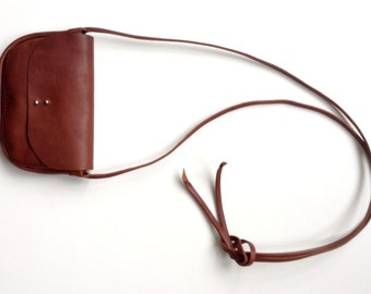 Small leather purse in cognac brown. Vegetable tanned minimalist hip purse / cross body bag in deep cognac brown by halfmoon