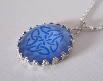 Celtic knot pendant glass cabochon blue on blue