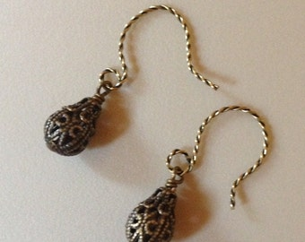 Earrings in antique brass with filigree beads .  AB0128