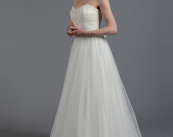 Strapless lace wedding dress, alencon lace with tulle skirt.