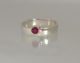 Rosy Ruby  a sterling silver alternative ring,  a beautiful 4mm rosy ruby, set in sterling silver offset for a contemporary look UK handmade