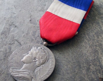vintage french medal with ribbon military coin woman's face red white blue france circa 1958