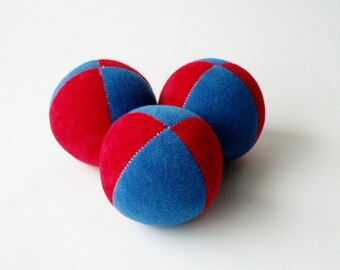 Set of 3 handmade 2.5inch juggling balls with packaging and instructions in blue&red