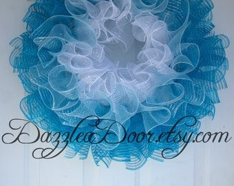 Blue Ombre Curly Q Deco Mesh Wreath. White, light blue, and teal deco mesh wreath.