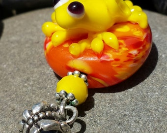 Cute frog glass lampwork bead pendant....yellow and orange frog bead pendant