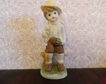 Marquise Collection Boy Holding Rabbit Figurine