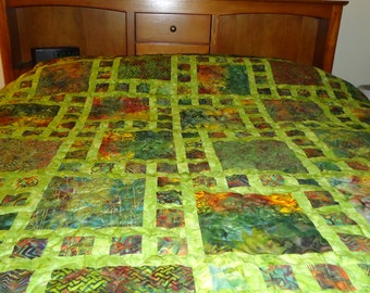 Price reduces.This is a 100% cotton handsewn queen size  quilt made with hand dyed batik  fabrics of green, burgundy, oranges and yellow gol