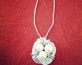 Silver birds nest becklace