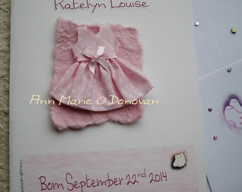 Stunning keepsake personalized baby girl  card, with cute dress  embellishment.