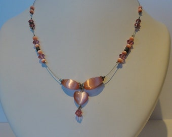 Necklace with combination of pink beads.