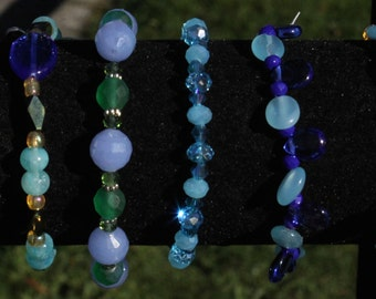 6 Hand Made Beautifully Designed Beaded Bracelets, Buy One, Or A Few To Stack, No matter Where You Wear Them You will Always Get Compliments