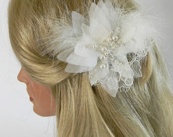 Samira Fascinator with lace and silk organza leaves.