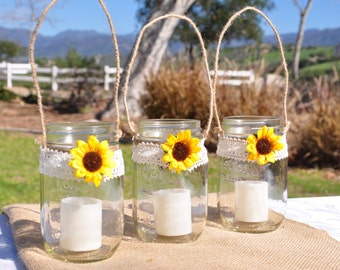 Hanging Mason Jar Candles with Lace and Flower embellishment.