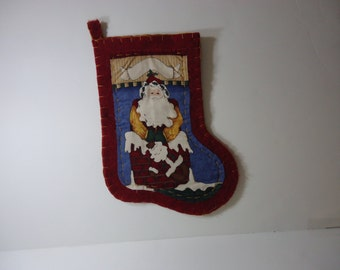 Handmade Santa Christmas stockings in red/burgundy  felt with applique on the front and the stocking measures 16 inches