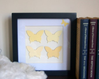 paper cut butterflies in honey oats framed