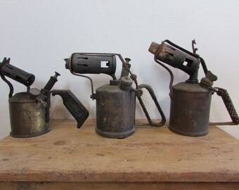 Three antique blowtorch excellent for cafe / restaurant display.