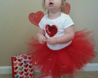 Red Heart Valentine's day tutu perfect for Valentine's day!  Avilable in 18 months to 2T and ready to be shipped today!!