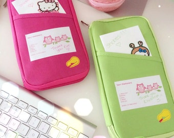 Cute Travel Planner Case. Filled with Stationery Supplies including Pens, Paper, Stickers, Sticky notes, paper clips.