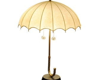 A Whimsical Brass and Hide Shade Umbrella-Form Table Lamp