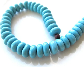 Glass beads in bright blue, 39 beads, 10 by 5mm - #157