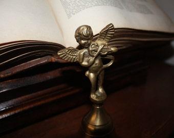 Vintage angel bell playing violin
