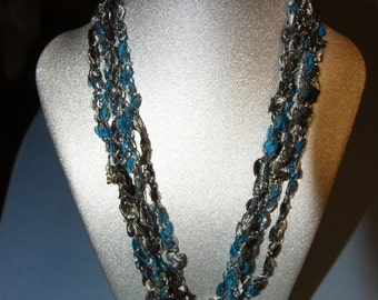Beautiful, vibrant blue brown silver colored,  lightweight crocheted necklace.  Adjustable length