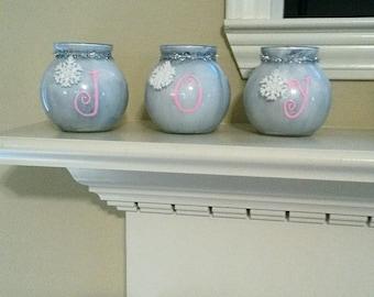 "Blue and pink ""JOY"" decorative glasses."