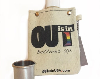 OUT is in Canvas Flask,  with shot glass, pride flask with shot glass, rainbow pride flask