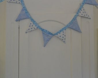 white and blue floral bunting