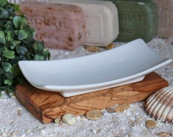 Porcelain soap dish on olive wood plate