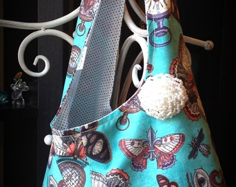 Steampunk tote. Knotted strap. Fully lined.  Butterflies, timepieces, compasses, beetles. Orange, turquoise, faux pearl brooch/pin.