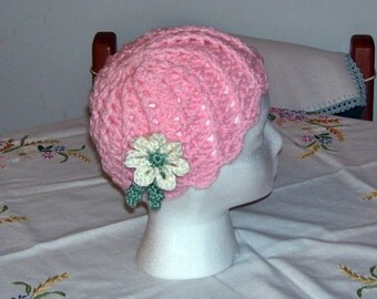 Sweetie is this pretty little cap with a flower