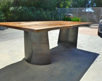 Live edge Walnut dinning table with corten steel bases