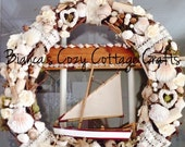 Sea shell wreath, maritime wreath, grapevine wreath, maritime doorhanger, lovely decorated with shells, driftwood, sail boat, beautiful deta