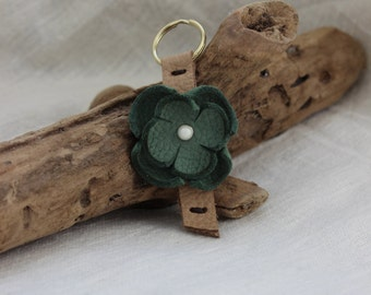 Leather keychain with a green flower