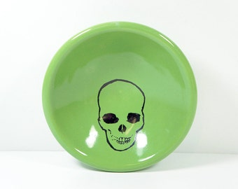 small dish with a skull print shown here on tinda melon green glaze, made to order / pick your colour