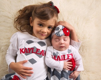 PERSONALIZED SISTER OUTFITS... baby gown and matching sister outfit.. in grey chevron and red accents--