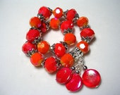 Reserved for TAZ Fire Bracelet Bright Pink and Orange Mother of Pearl Stretch Bracelet