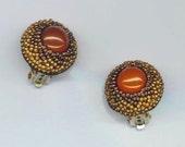 Beadwoven Carnelian Earrings . Beaded Clip On Earrings . Carnelian Cabochon . Golden Seed beads- Perfect Ear Clips by enchantedbeads on Etsy