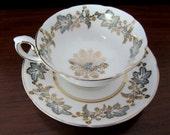 Royal Grafton Fine Bone China Blue Leaf and Gold Teacup and Saucer Set