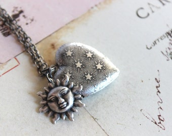 sun and stars. heart locket necklace. in silver ox jewelry