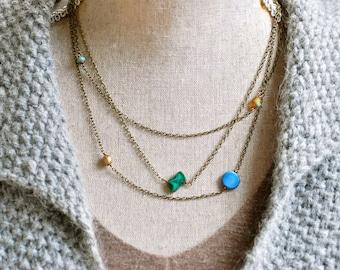 Orbit. layered asymmetrical beaded necklace. Tiedupmemories
