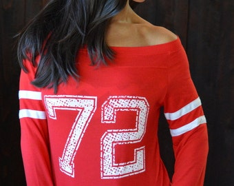 CUSTOM Number. Seven Colors to Choose From. Sizes S-XL. Wide Shouldered Sporty Long Sleeved Tee.  Made in the Usa.