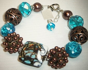 Lovely Turquoise and Brown Jesse James Beads, Lampwork Beads, & Crystal Beads Bracelet
