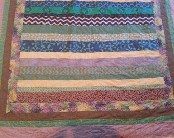 purple and turquoise twin size quilt