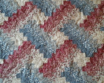 red, blue and tan weaver fever quilt