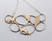 Menagerie Organic Pendant Necklace in Sterling Silver and Brass with Wolf, Hawk, Owl, and Fox